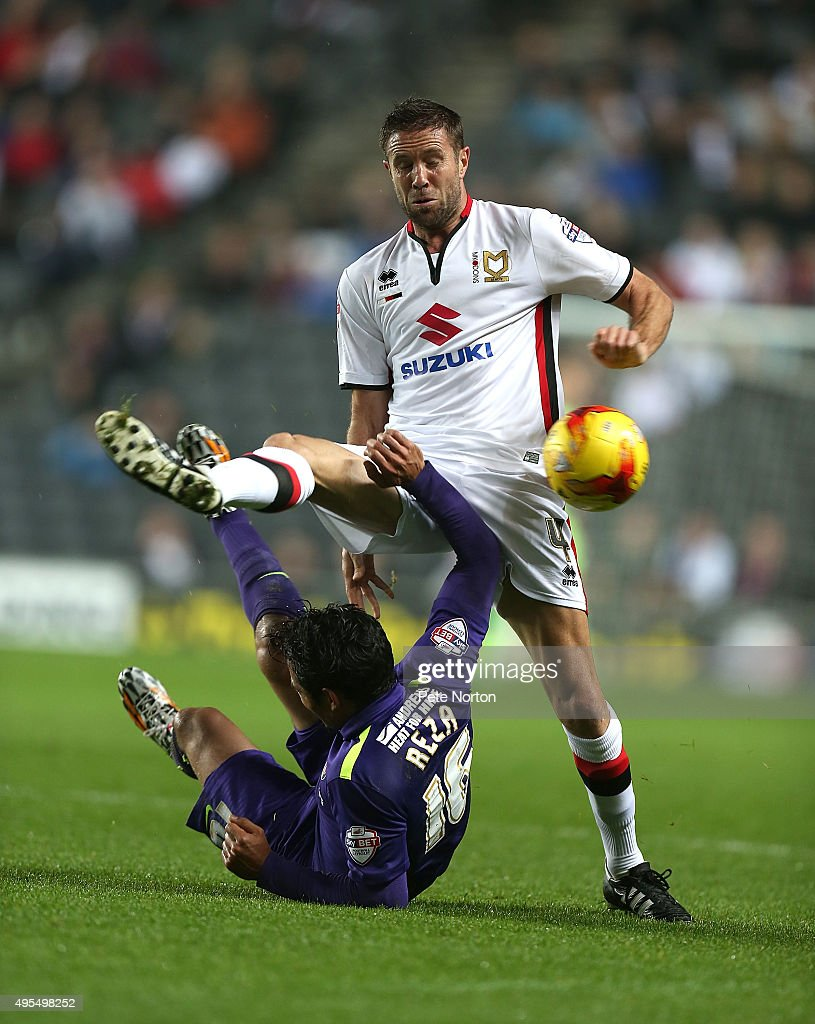 Matthew Upton of MK Dons challenges for the ball with Reza Ghoochannejhad of Charlton Athletic during the Sky Bet Championship game between Milton Keynes Dons and Charlton Athletic at Stadium MK on November 3, 2015 in Milton Keynes, United Kingdom.