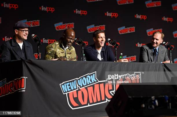 """Matthew Vaughn, Djimon Hounsou, Harris Dickinson, and Ralph Fiennes speak onstage during """"The King's Man"""" at New York Comic Con at The Jacob K...."""