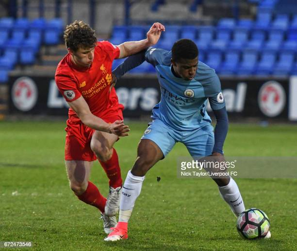 Matthew Virtue of Liverpool and Javairo Dilrosun of Manchester City in action during the Liverpool v Manchester City Premier League 2 game at Prenton...