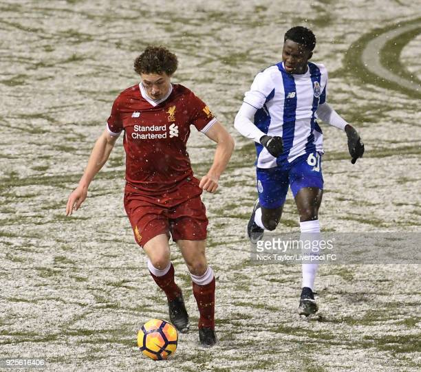 Matthew Virtue of Liverpool and Madi Queta of Porto in action during the Liverpool v Porto Premier League International Cup game at Leigh Sports...