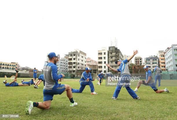 Matthew Wade and David Warner of Australia warm up during an Australian Test team nets session at SherE Bangla National Cricket Stadium Cricket...