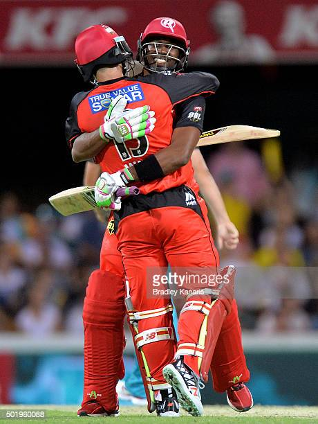 Matthew Wade and Dwayne Bravo of the Renegades celebrate victory after the Big Bash League match between the Brisbane Heat and the Melbourne...