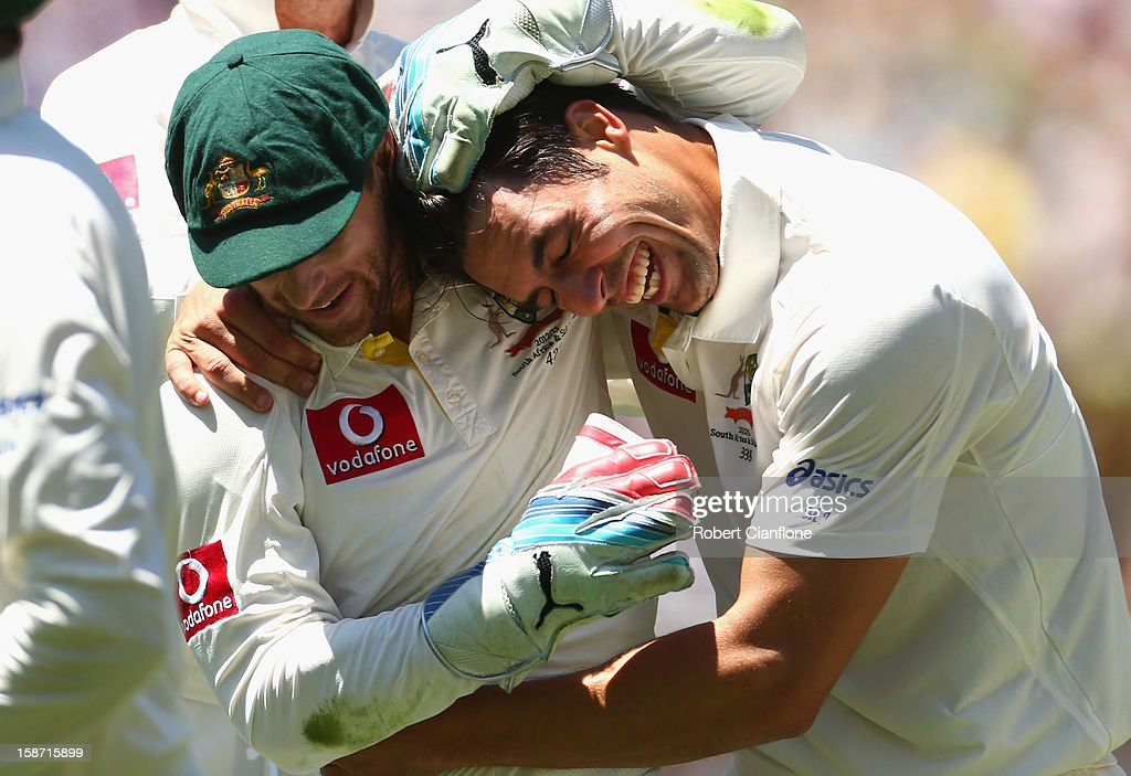 Matthew Wade and Mitchell Johnson of Australia celebrates after they dismissed Kumar Sangakkara of Sri Lanka during day one of the Second Test match between Australia and Sri Lanka at Melbourne Cricket Ground on December 26, 2012 in Melbourne, Australia.