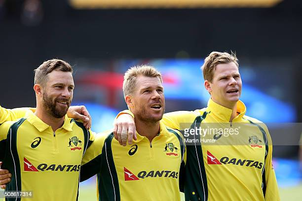 Matthew Wade David Warner and Steve Smith of Australia sing their national antham during game two of the one day international series between New...