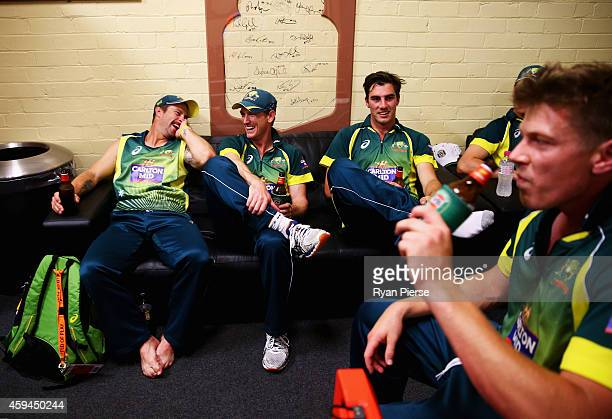 Matthew Wade George Bailey Pat Cummins and James Faulkner of Australia celebrate in the change rooms after game five of the One Day International...