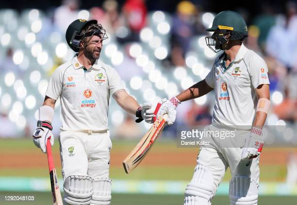 Matthew Wade of Australia and Joe Burns of Australia walk from the ground at team during day three of the First Test match between Australia and...