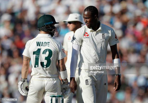 Matthew Wade of Australia and Jofra Archer of England exchange words during day four of the 5th Specsavers Ashes Test between England and Australia...