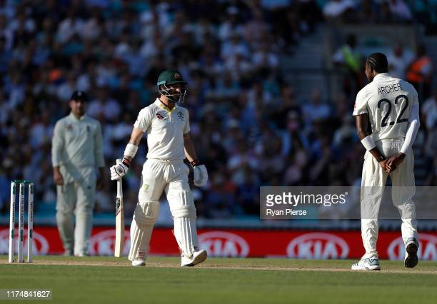 Matthew Wade of Australia and Jofra Archer of England stare at each other during day four of the 5th Specsavers Ashes Test between England and...