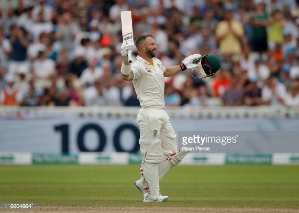 Matthew Wade of Australia celebrates after reaching his century during day four of the 1st Specsavers Ashes Test between England and Australia at...