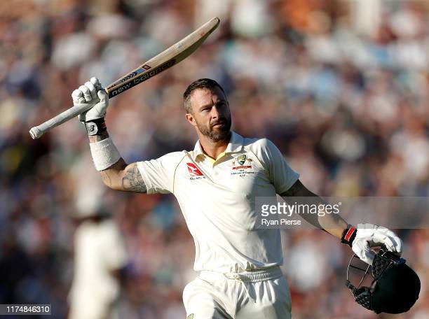 Matthew Wade of Australia celebrates after reaching his century during day four of the 5th Specsavers Ashes Test between England and Australia at The...