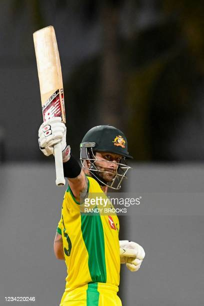 Matthew Wade of Australia celebrates his half century during the 3rd and final ODI between West Indies and Australia at Kensington Oval, Bridgetown,...
