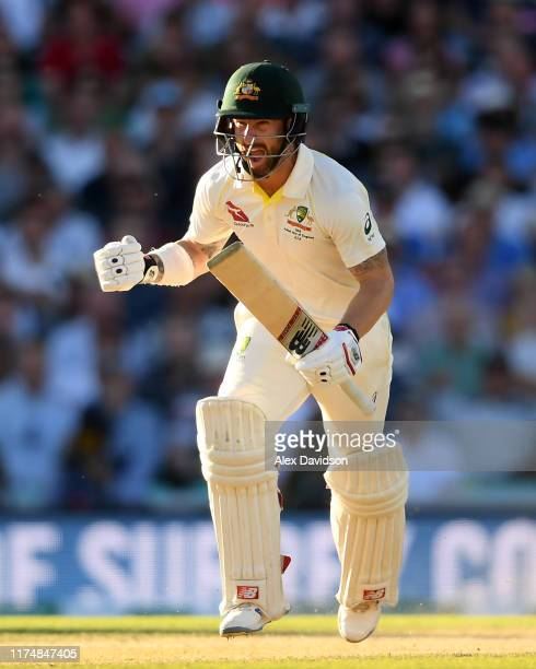 Matthew Wade of Australia celebrates reaching his century during Day Four of the 5th Specsavers Ashes Test between England and Australia at The Kia...