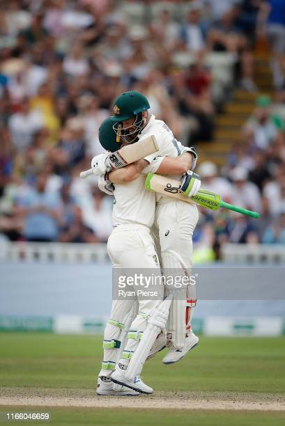 Matthew Wade of Australia celebrates with Tim Paine of Australia after reaching his century during day four of the 1st Specsavers Ashes Test between...