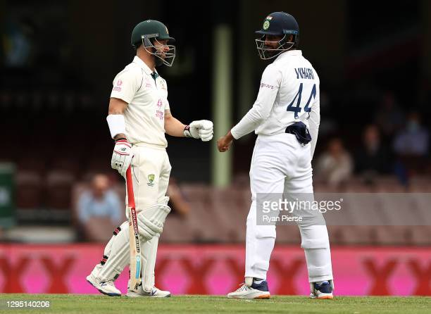 Matthew Wade of Australia check on Hanuma Vihari of India after hitting the ball into him during day two of the 3rd Test match in the series between...