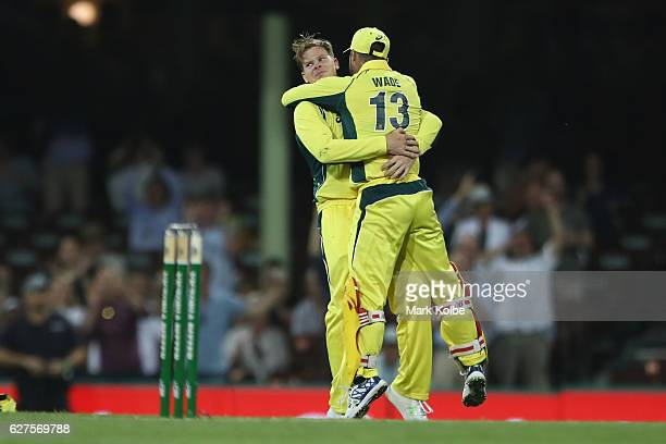 Matthew Wade of Australia congratulates Steven Smith after he took the catch to dismiss BJ Watling of New Zealand during game one of the One Day...