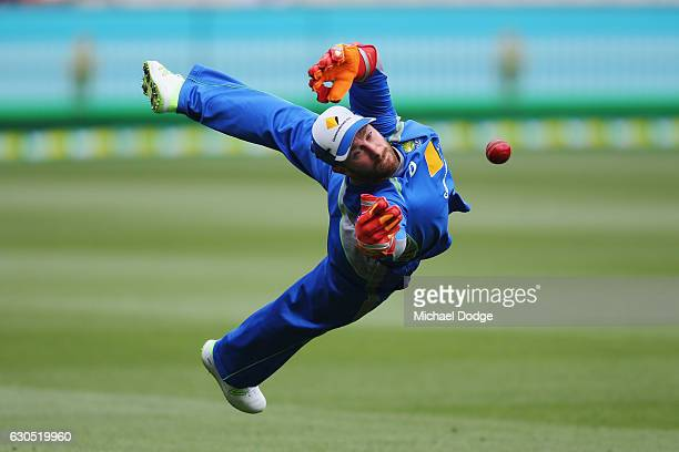 Matthew Wade of Australia dives for a ball in warm up during day one of the Second Test match between Australia and Pakistan at Melbourne Cricket...