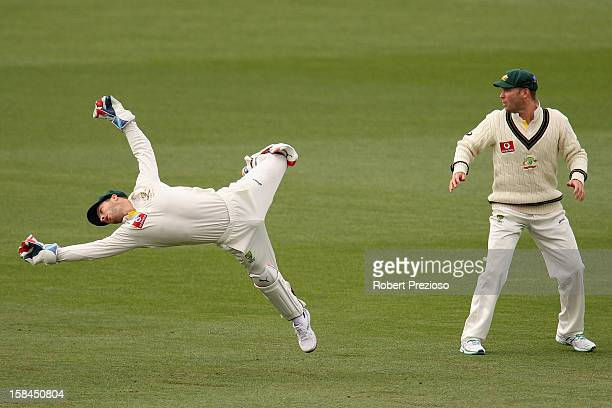Matthew Wade of Australia dives for the ball during day four of the First Test match between Australia and Sri Lanka at Blundstone Arena on December...