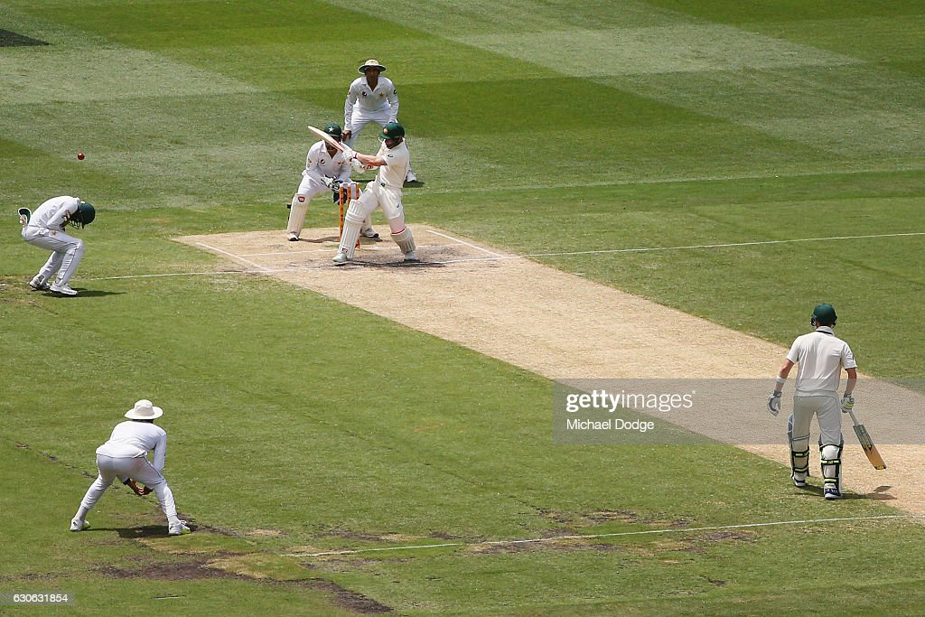 Matthew Wade of Australia hits the ball into Azhar Ali of Pakistan who was taken off as a result during day four of the Second Test match between Australia and Pakistan at Melbourne Cricket Ground on December 29, 2016 in Melbourne, Australia.