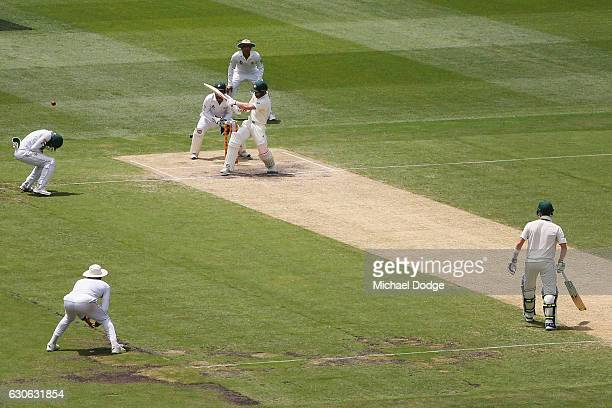Matthew Wade of Australia hits the ball into Azhar Ali of Pakistan who was taken off as a result during day four of the Second Test match between...