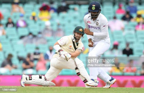 Matthew Wade of Australia hits the ball into Hanuma Vihari of India during day two of the third Test match between Australia and India at Sydney...