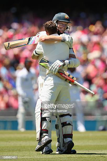 Matthew Wade of Australia is congratulated by team mate Jackson Bird after scoring a century during day three of the Third Test match between...