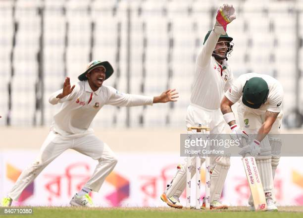 Matthew Wade of Australia is given out LBW to Shakib Al Hasan of Bangladesh during day four of the First Test match between Bangladesh and Australia...
