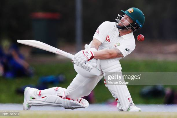 Matthew Wade of Australia is hit on the helmet from a Nathan Lyon delivery during day three of the Australian Test cricket intersquad match at...