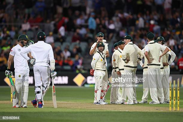 Matthew Wade of Australia looks at Kagiso Rabada of South Africa after stumping him out of his crease during day one of the Third Test match between...