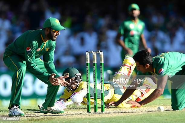 Matthew Wade of Australia makes his ground during game one of the One Day International series between Australia and Pakistan at The Gabba on January...