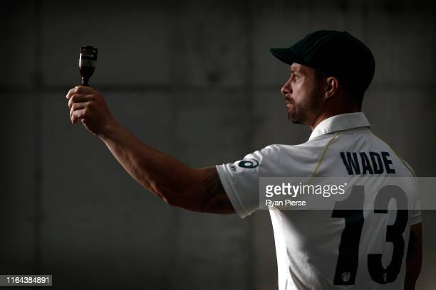 Matthew Wade of Australia poses with a replica Ashes Urn after the Australia Ashes Squad Announcement at The Ageas Bowl on July 26, 2019 in...