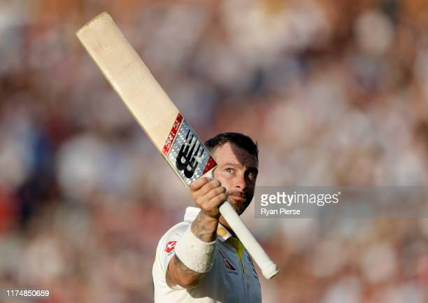 Matthew Wade of Australia raises his bat as he leaves the ground after being dismissed for 117 runs during day four of the 5th Specsavers Ashes Test...