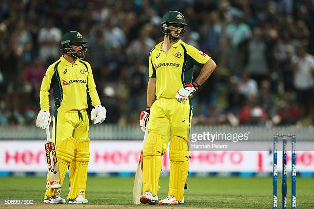 Matthew Wade of Australia waits with Mitchell Marsh of Australia for the umpires to review a decision during the 3rd One Day International cricket...