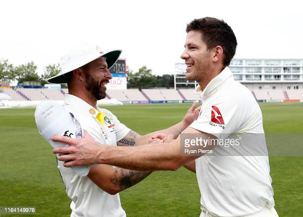 Matthew Wade of Graeme Hick XII congratulates Tim Paine of Graeme Hick XII after day three of the Australian Cricket Team Ashes Tour match between...