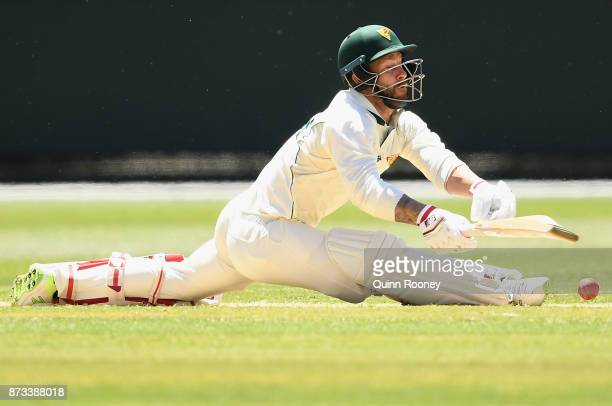 Matthew Wade of Tasmania slips whilst playing a sweep shot during day one of the Sheffield Shield match between Victoria and Tasmania at Melbourne...