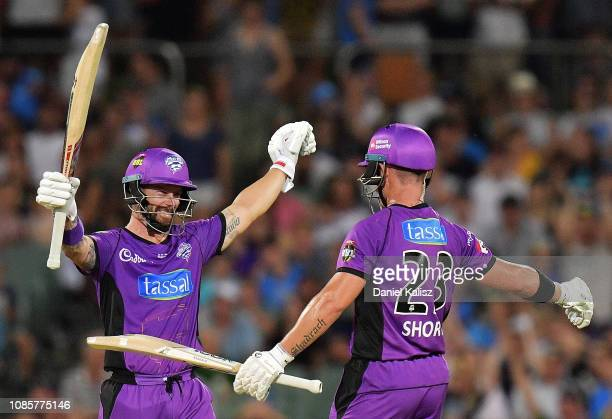 Matthew Wade of the Hobart Hurricanes and D'Arcy Short of the Hobart Hurricanes celebrate after defeating the Strikers during the Big Bash League...