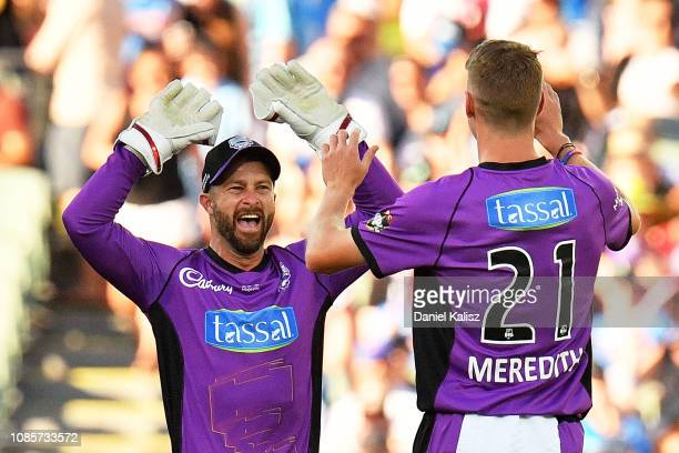 Matthew Wade of the Hobart Hurricanes celebrates with Riley Meredith of the Hobart Hurricanes during the Big Bash League match between the Adelaide...