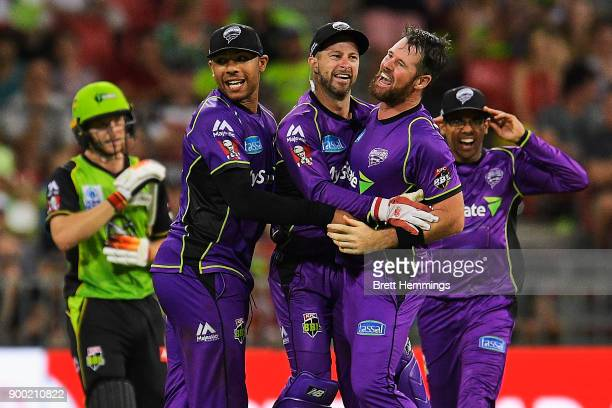 Matthew Wade of the Hurricanes celebrates running out Jos Buttler of the Thunder during the Big Bash League match between the Sydney Thunder and the...
