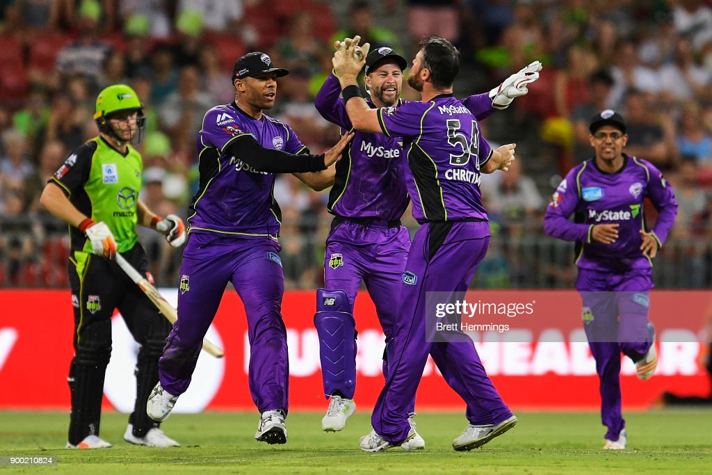 Matthew Wade of the Hurricanes celebrates running out Jos Buttler of the Thunder during the Big Bash League match between the Sydney Thunder and the Hobart Hurricanes at Spotless Stadium on January 1, 2018 in Sydney, Australia.