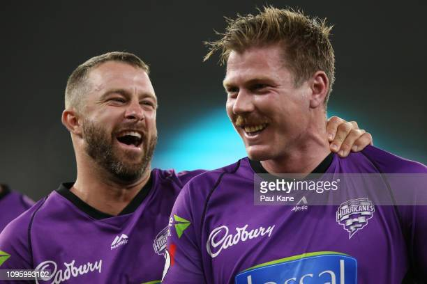 Matthew Wade of the Hurricanes shares a moment with James Faulkner while walking from the field after winning the Big Bash League match between the...