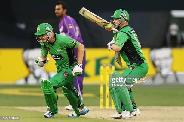 Matthew Wade of the Stars holds the bat of Luke Wright after colliding with him while running together on the pitch during the Big Bash League Semi...