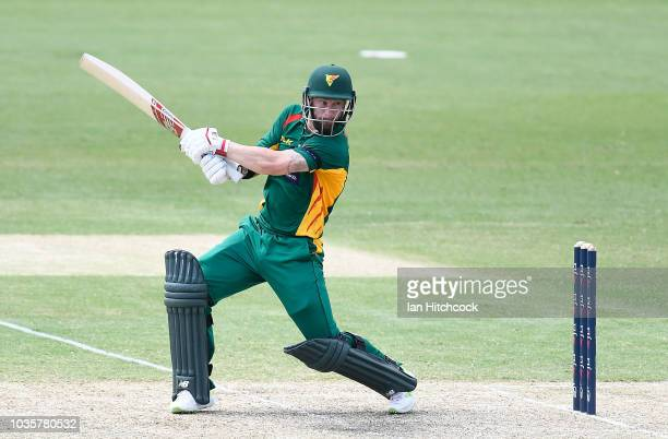 Ben McDermott of the Tigers waves to the crowd after scoring his half century during the JLT One Day Cup match between Tasmania and Victoria at...