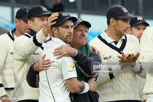 Matthew Wade of Victoria and coach Greg Shipperd of Victoria celebrate after a win during day five of the Sheffield Shield final match between...