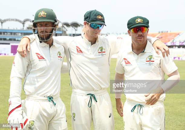 Matthew Wade Steve Smith and David Warner of Australia wait to take to the field after the lunch break during day four of the Second Test match...