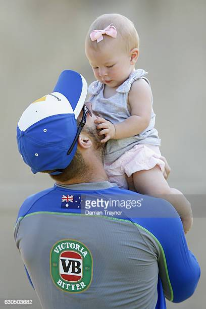 Matthew Wade takes a break with his child Winter during an Australian nets session on December 25 2016 in Melbourne Australia