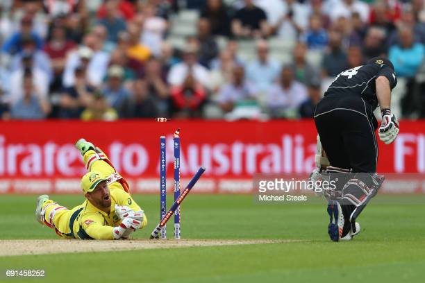Matthew Wade the wicketkeeper of Australia misses an opportunity to run out Luke Ronchi of New Zealand during the ICC Champions Trophy match between...
