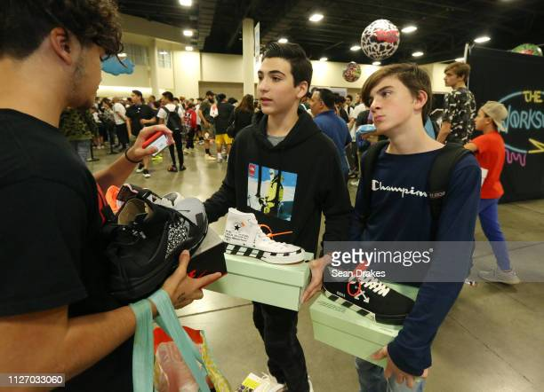 Matthew Weinstein and Zachary Levin display sneakers for sale during SneakerCon 2019 at Fort Lauderdale Convention Center on February 2 2019 in Fort...