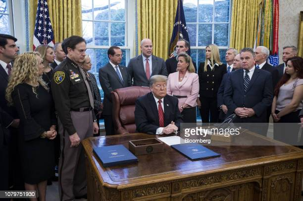 Matthew Whitaker acting US attorney general center top speaks during a signing ceremony for antihuman trafficking legislation with US President...