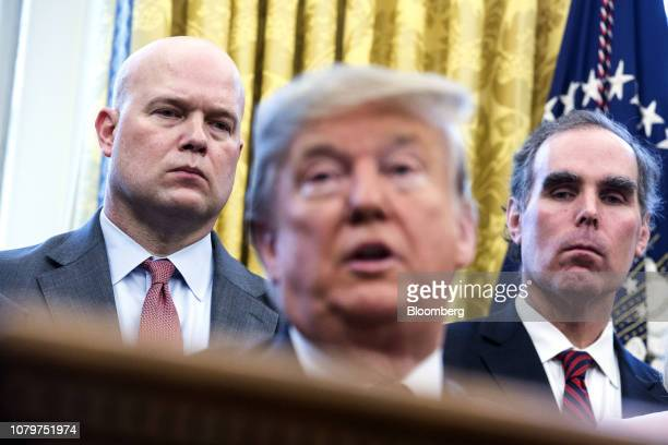 Matthew Whitaker acting US attorney general left and Eric Dreiband assistant US attorney general right listen as US President Donald Trump speaks...