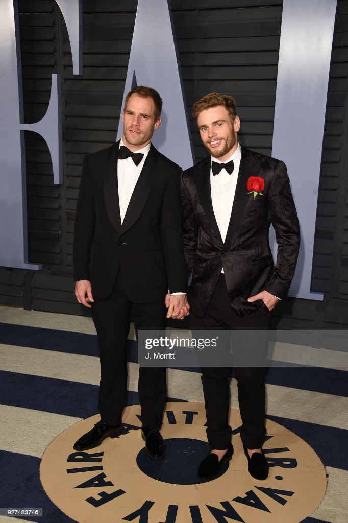 Matthew Wilkas (L) and skier Gus Kenworthy attend the 2018 Vanity Fair Oscar Party hosted by Radhika Jones at the Wallis Annenberg Center for the Performing Arts on March 4, 2018 in Beverly Hills, California.