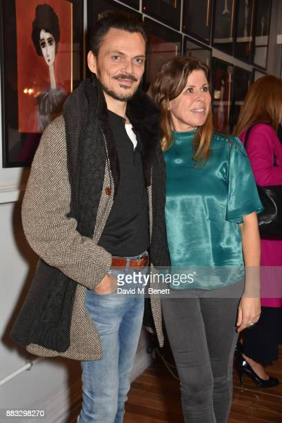 Matthew Williamson and Rebecca Leigh attend a private view of artist Rebecca Leigh's exhibition hosted by Sadie Frost at Tann Rokka on November 30,...